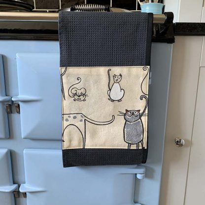 Cat and Mouse Beige Roller Towel on kitchen Aga