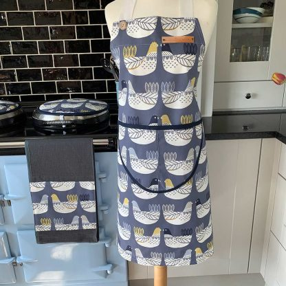 Cluck Cluck Blue Bird Apron on mannequin